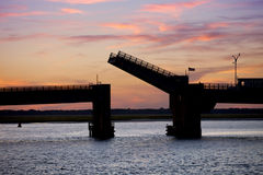 Silhouette of an open drawbridge Stock Photography