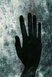 Silhouette of an open hand Stock Photo
