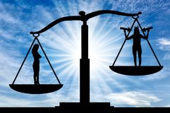 Concept of egoism as a problem in a normal society. Silhouette of an ordinary woman on the scales of justice in priority over a selfish woman with a crown on her Royalty Free Stock Image