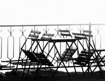 Silhouette of outdoor furniture in fog. Stock Image