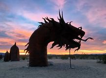 Silhouette of an outdoor Serpent Sculpture during a colorful sunrise Stock Photography