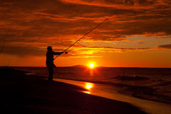 Silhouette over fisherman Royalty Free Stock Image