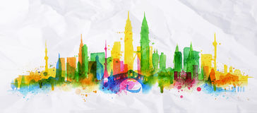 Silhouette overlay city Kuala Lumpur. Silhouette overlay city painted with splashes of watercolor drops streaks landmarks with a yellow-green colors Royalty Free Stock Photos