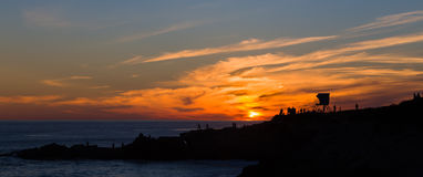 Silhouette of Pacifc Coast Sunset. Silhouette of people watching the sun set over the Pacific Ocean at Leo Carillo State Beach Royalty Free Stock Photo