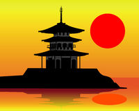Silhouette of a pagoda. On an orange background Royalty Free Stock Images
