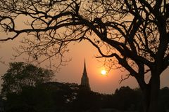 Silhouette of Pagoda twilight scenes in Ayutthaya historical Park. Royalty Free Stock Photos