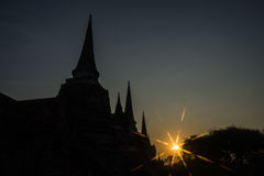 Silhouette Pagodas with sun stars Stock Images