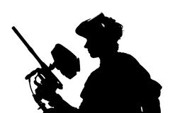 Silhouette of a paintball shooter Royalty Free Stock Photo