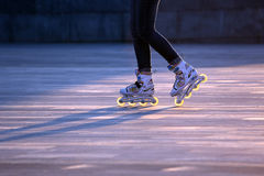 Silhouette pairs of legs on roller skates. The silhouette pairs of legs on roller skates Stock Images