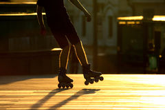 Silhouette pairs of legs on roller skates. The silhouette pairs of legs on roller skates Royalty Free Stock Photos
