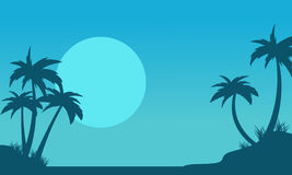 Silhouette of palm with big moon scenery Stock Image