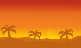 Silhouette of palm on dessert scenery Royalty Free Stock Photography