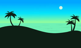 Silhouette of palm on seaside scenery Royalty Free Stock Photo
