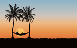 Silhouette palm tree with hammock on beach under sunset sky background. Silhouette palm tree with hammock on beach under sunset sky Royalty Free Stock Photo