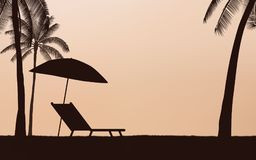 Silhouette palm tree with umbrella and chairs on beach under sunset sky background Royalty Free Stock Images