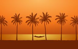 Silhouette palm tree with woman in hammock on beach under sunset sky background Royalty Free Stock Photos