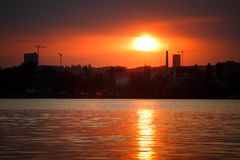 Silhouette panorama at sunset colorful sky over Dnipro river. In Kyiv royalty free stock image