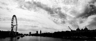 Silhouette panorama of Thames river with London Eye, UK Royalty Free Stock Photo