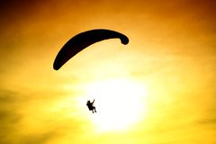Silhouette of parachute on sunset Royalty Free Stock Image