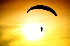 Silhouette of parachute on sunset Stock Photo