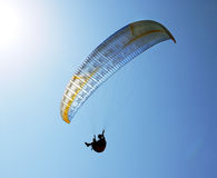 Silhouette of paraglider against the blue sky Royalty Free Stock Image