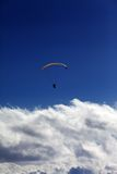 Silhouette of paraglider and blue sky with clouds Royalty Free Stock Photo