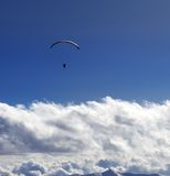Silhouette of paraglider and blue sun sky Royalty Free Stock Photo