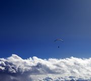 Silhouette of paraglider and blue sunny sky Royalty Free Stock Image