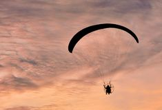 Paragliding flying on the sky sunset background Stock Images