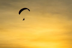 Silhouette Paramotor, Parachute, Paraglide flying in the sunset Stock Images