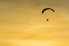 Silhouette Paramotor, Parachute, Paraglide flying in the sunset Royalty Free Stock Photos