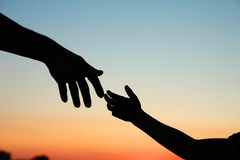 Silhouette parent and child hands. Nice silhouette parent and child hands Stock Images