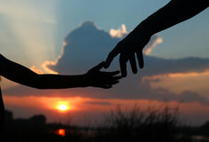 Silhouette the parent holds the hand of a  child Stock Images