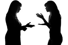 Silhouette of parenting daughter of a teenager. On white isolated background, parent screaming, teenager show Disagreement stock photography