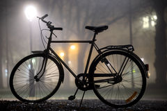 Silhouette of parked bicycle Royalty Free Stock Photo
