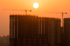 Silhouette of partially completed building in Noida Stock Photo