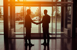 Silhouette of partnership handshake Stock Image