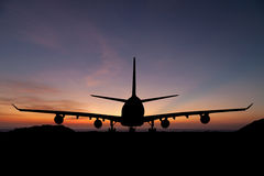 Silhouette of  passenger aircraft, airline on beautiful sunset Royalty Free Stock Photos