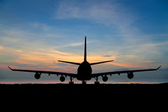 Silhouette of  passenger aircraft, airline on beautiful sunset Royalty Free Stock Image