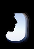 Silhouette of a Passenger in the Airplane. Silhouette of a woman face sitting next to the window in the Airplane Royalty Free Stock Photos