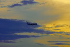 Silhouette of an passenger airplane against sunset sky. Background Royalty Free Stock Photography