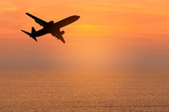Free Silhouette Passenger Airplane Flying Away In To Sky High Altitude During Sunset Time Royalty Free Stock Image - 104000676