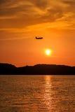 Silhouette of Passenger Airplane Landing at sunset Royalty Free Stock Photo