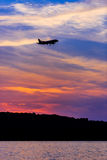 Silhouette of Passenger Airplane Landing at sunset Royalty Free Stock Photo