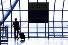 Silhouette of passenger in the airport. Interior of the airport Royalty Free Stock Photography