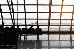 Silhouette of passengers waiting for the airplane Royalty Free Stock Photos