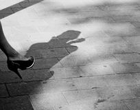 Silhouette on a pavement Stock Image