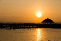 Silhouette pavilion in lake during sunset,ancient pavilion in la stock photography