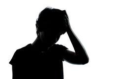 Silhouette pensante de problèmes de garçon ou de fille d'adolescent Photo libre de droits