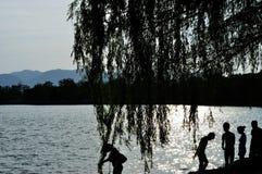 Silhouette of  people. Silhouette of people on the shore Stock Image